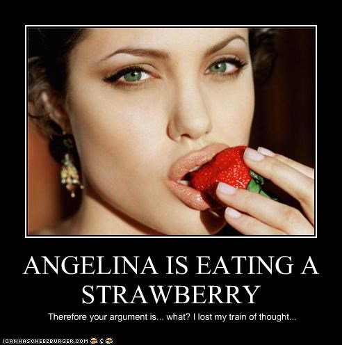 ANGELINA IS EATING A STRAWBERRY