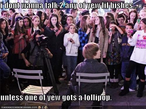 singers,fans,justin bieber,lollipops,mean,rude