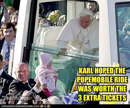 KARL HOPED THE POPEMOBILE RIDE WAS WORTH THE  3 EXTRA TICKETS