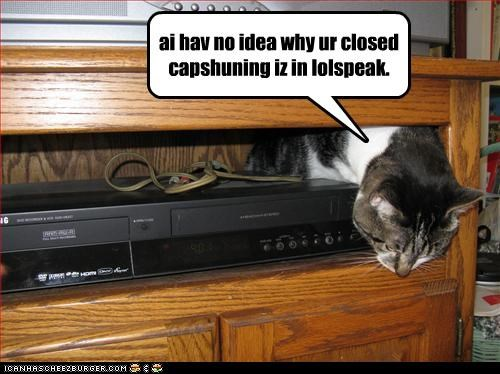 caption,captioned,cat,closed captioning,denial,lolspeak,playing dumb,tampering,technology,vcr