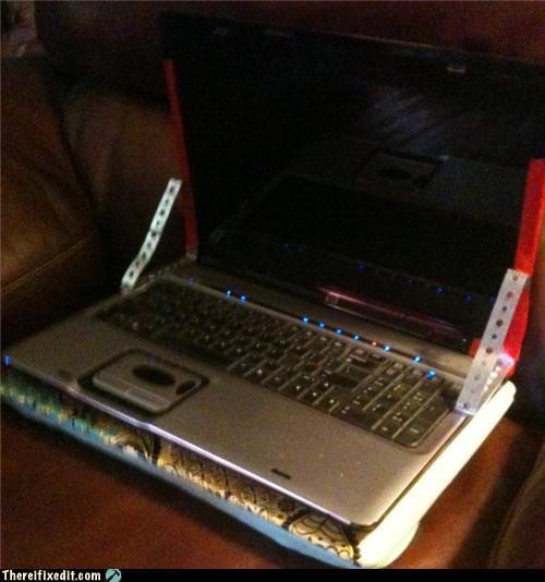 brace,holding it up,laptop