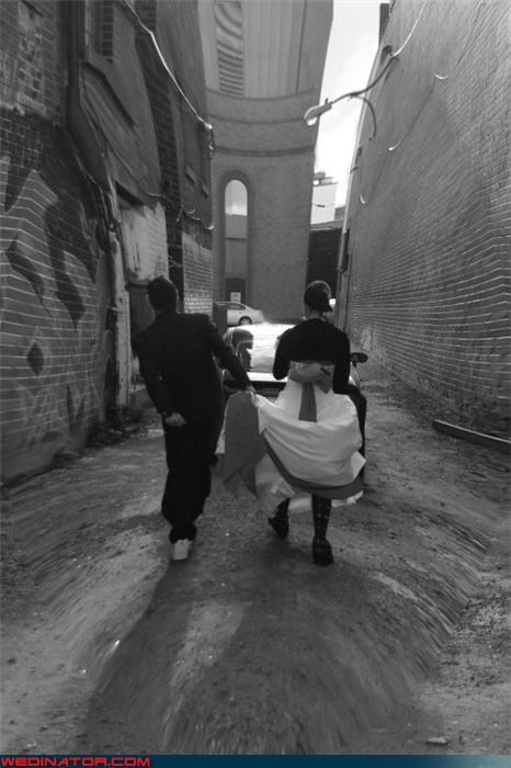 black and white,bride,crazy groom,eww,fashion is my passion,funny bride and groom picture,funny groom picture,funny wedding photos,funny wedgie picture,groom picks wedgie,miscellaneous-oops,multi tasking,technical difficult