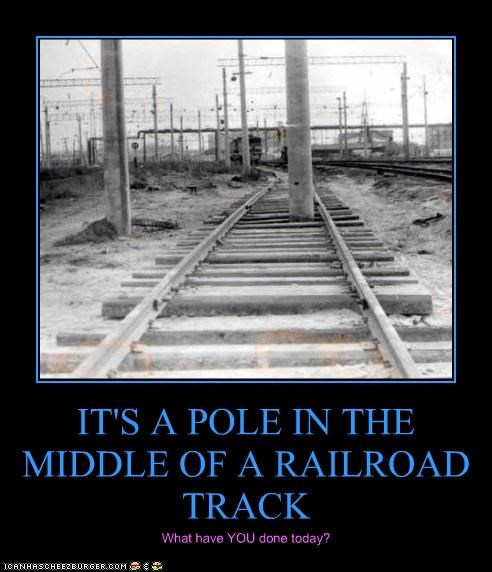 IT'S A POLE IN THE MIDDLE OF A RAILROAD TRACK