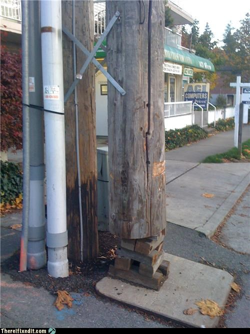 holding it up,jenga,tax dollars at work,utility pole