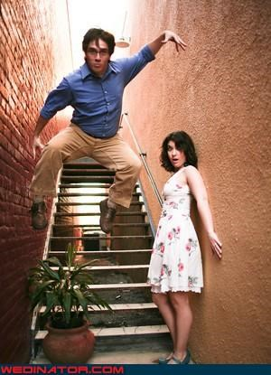 bride,crazy groom,engagement photo shoot,fashion is my passion,funny bride photo,funny engagement jumping photo,funny engagement photo,funny groom photo,funny wedding photos,groom,jumping craze,jumping wedding photo,surprise,wtf