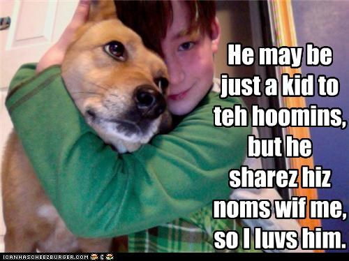He may be just a kid to teh hoomins, but he sharez hiz noms wif me, so I luvs him.