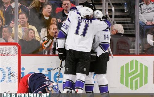 flipping the bird,hockey,middle finger,photobomb,referee