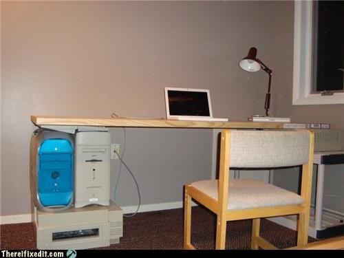 college,computer parts,desk,holding it up,obsolete
