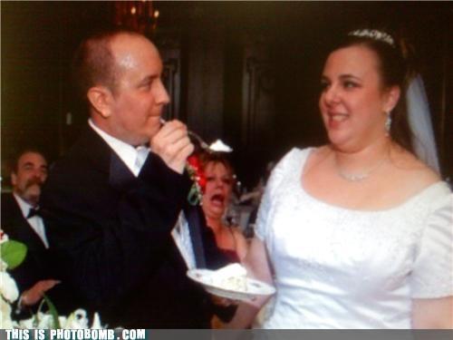 Awkward,bride,cake,groom,wedding