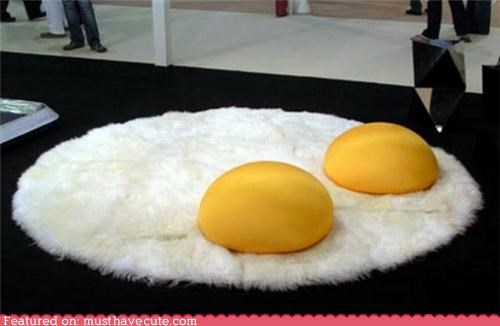 deor,eggs,floor,pillows,rug,sunny side up