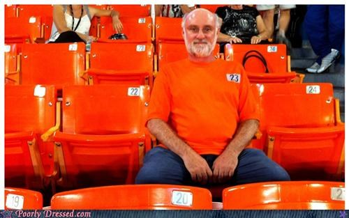camo,orange shirt,stadium