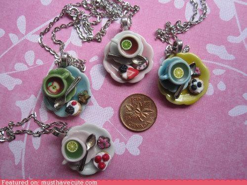 chain,cup,fruit,necklace,pastries,pendant,saucer,snack,tea