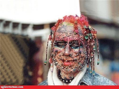 dredlocks,face piercings,face tattoos
