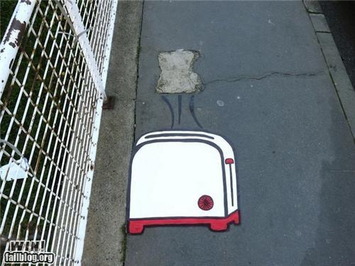 appliance,breakfast,food,graffiti,hacked irl,sidewalk,Street Art,toast