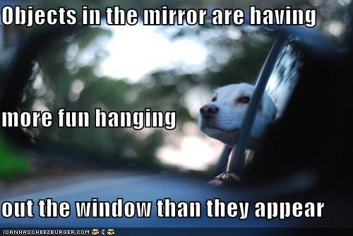 Objects in the mirror are having more fun hanging out the window than they appear