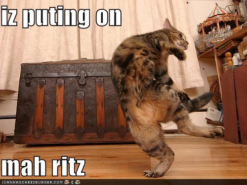 iz puting on  mah ritz