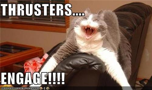 caption,captioned,cat,Command,couch,engage,fast,holding,shouting,speed,thrusters,warp