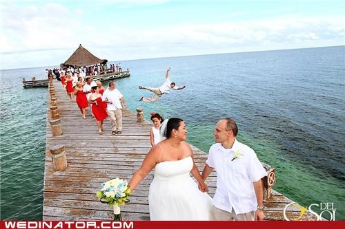 beach,bride,funny wedding photos,groom,groomsman,jump,ocean,photobomb,wedding party