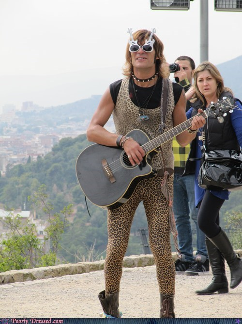 With his leopard print and guitar he makes beautiful music