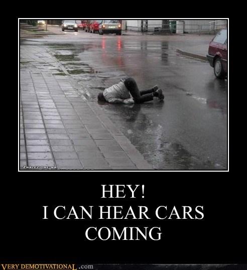 bad idea,cars,dude,idiots,lying down,road,traffic