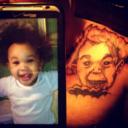 Kid Looks Happy Now, But Wait Until He Sees the Tattoo