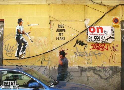 balance,graffiti,hacked irl,juggle,Street Art,unicycle,wire