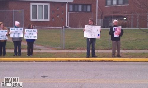 coke,counter-protest,Protest,sign,soda,vanilla coke