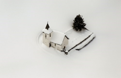 Arial View of a Church Covered in Snow in Switzerland