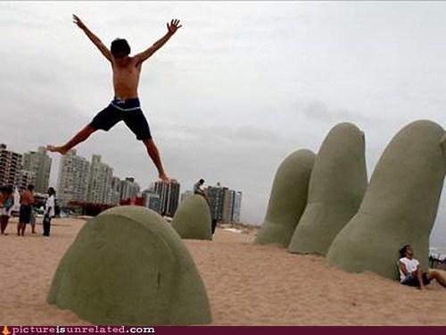 beach,hand,rock,statue,wtf