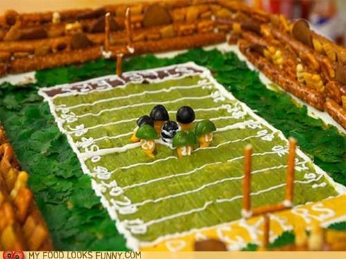 football field,helmets,olives,pretzels,super bowl