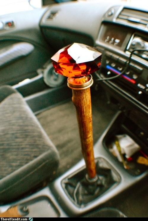 car,drivers-seat,pimp cane,stick shift