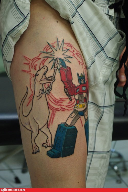 g rated,high five,optimus prime,tattoo WIN,transformers,t rex,Ugliest Tattoos