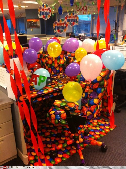 annoyed,birthday,cubicle,desk,grateful,presents,wrapping paper