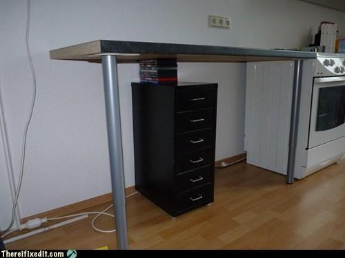 cds,desk,dvds,file cabinet,kitchen,kitchen table,shelf,table