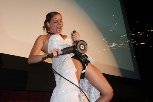 Photoshop Battle of the Day: This Bride Cutting Her Chastity Belt Didn't Need Any Photoshopping, but the Internet Gave Her Some Anyway
