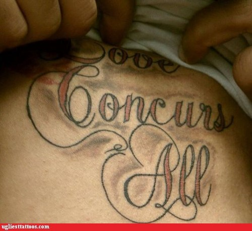 concurs,love conquers all,misspelled tattoos