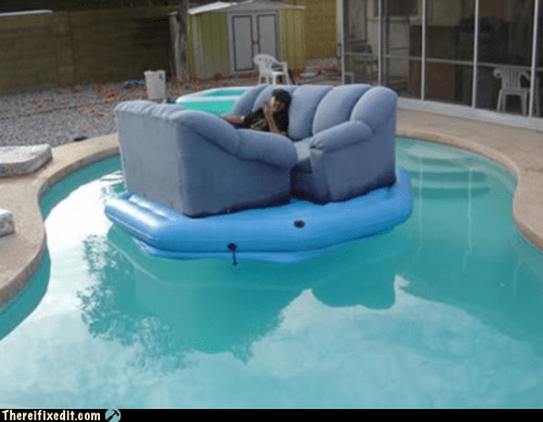 couch,couch boat,flotation device,pool,remote