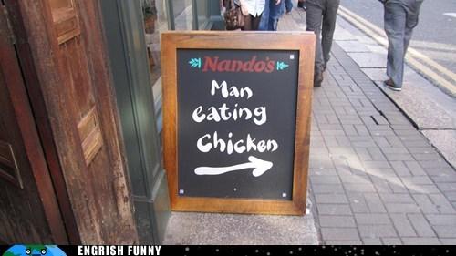man eating chicken,nandos,restaurant