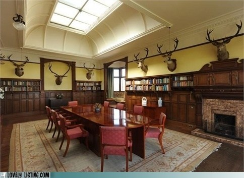 bookcases,deer,dining room,fireplace,table,taxidermy