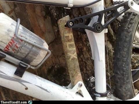 bicycle,log,stick,suspension,wood