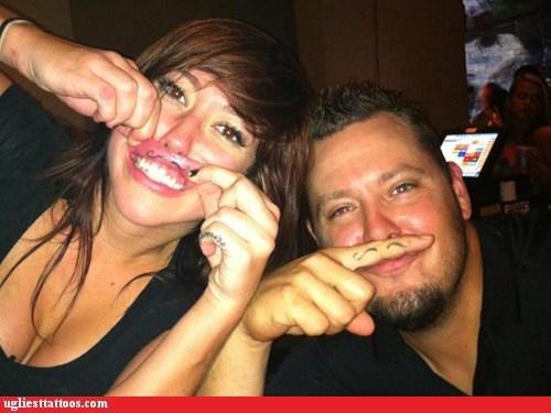 finger tattoos,lip tattoos,mustache tattoos