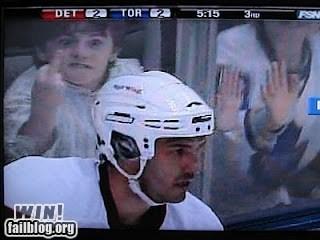 fan,middle finger,NHL,sports,the bird