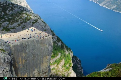 A Long Way Down at the Cliff of Preikestolen, Norway