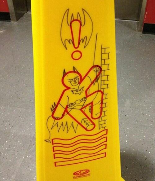 batman,caution,graffiti,hacked irl,sign,wet floor