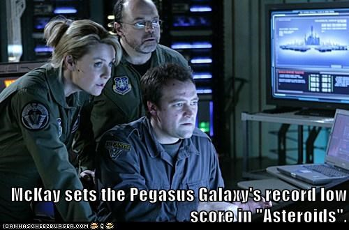 "McKay sets the Pegasus Galaxy's record low score in ""Asteroids""."