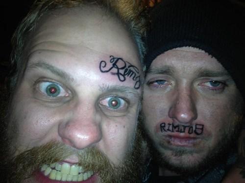 forehead tattoos,lip tattoos
