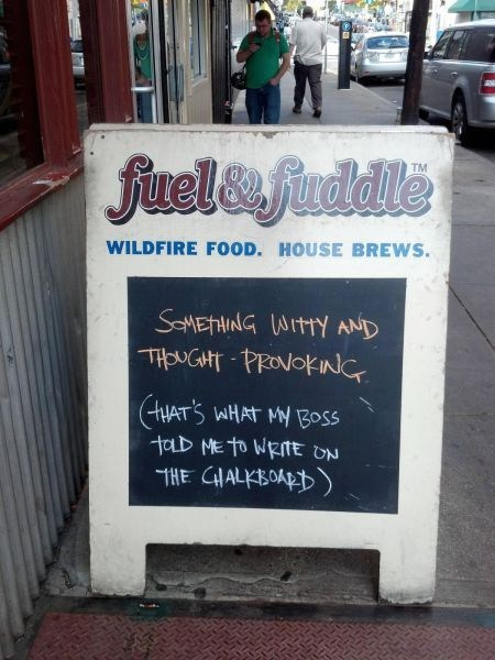 restaurant sign,chalk sign,restaurant,fuel and fuddle,monday thru friday,g rated