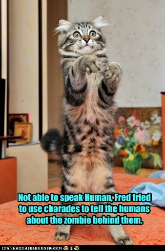 Not able to speak Human, Fred tried to use charades to tell the humans about the zombie behind them.