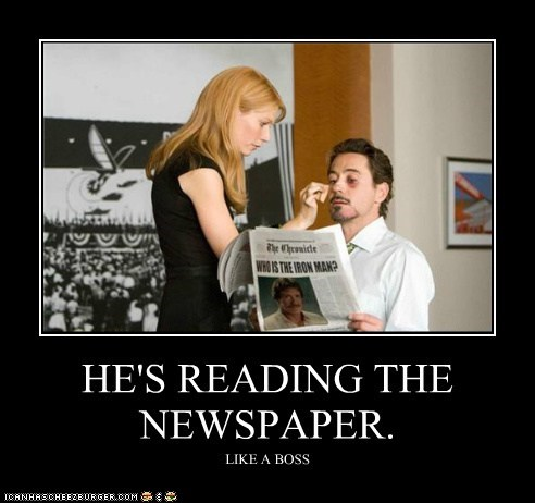 HE'S READING THE NEWSPAPER.