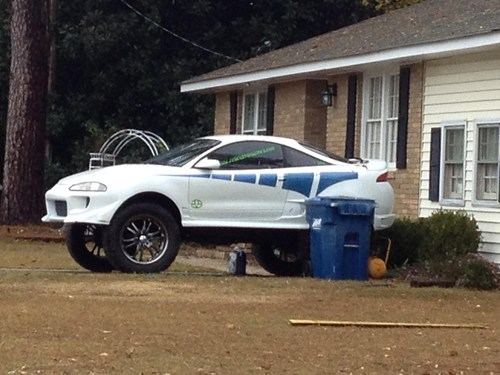 lifted car,big wheels,big tires,suped up car